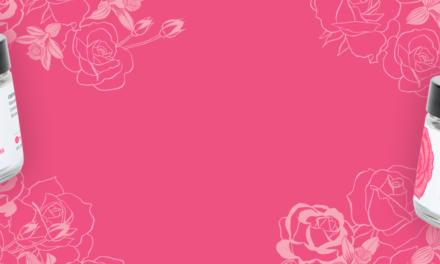 Two jars of Schmidt's rose and vanilla deodorant with a pink background with rose illustrations