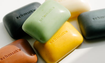 A variety of schmidt's bar soap laid on a white background